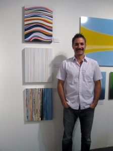 artist Sean Brannan with his work