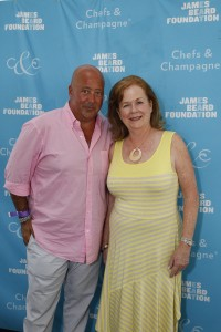 CC 2013 Photo 0: 2013 Honoree Andrew Zimmern with James Beard Foundation President Susan Ungaro at the James Beard Foundation's Chefs & Champagne® New York fundraiser honoring Andrew Zimmern at Wölffer Estate Vineyard in the Hamptons on July 20, 2013. Photo by Mark Von Holden.